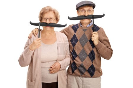 Cheerful seniors with big fake moustaches