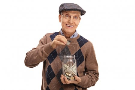 Elderly man putting a coin into a jar with money