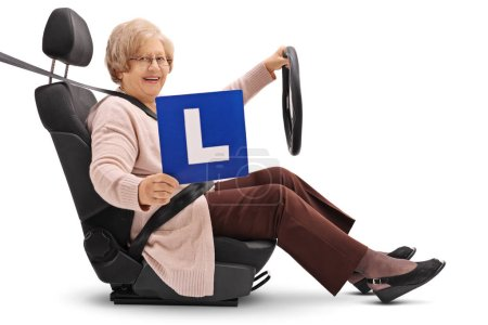 Elderly woman in a car seat showing an L-sign