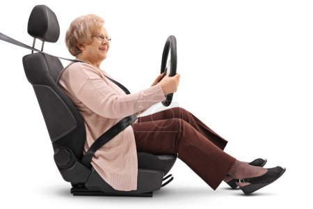 Mature woman in a car seat holding a steering wheel