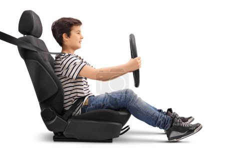 Boy sitting on a car seat pretending to drive