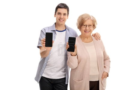 man and mature woman showing phones to the camera