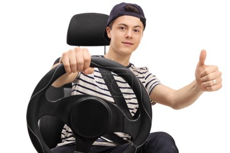 Teenager seated in car seat giving thumb up