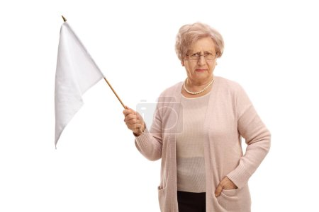 Disappointed mature woman holding a white flag