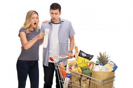 Shocked couple looking at a shopping bill