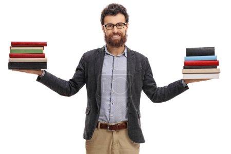 Photo pour Enseignant avec deux piles de livres isolés sur fond blanc - image libre de droit