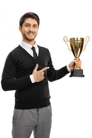 guy holding a gold trophy and pointing