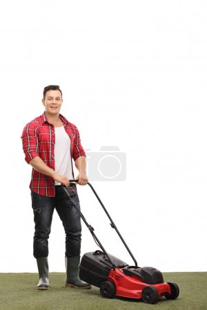 Young gardener with a lawnmower
