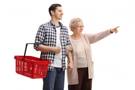 man holding a shopping basket with elderly woman pointing