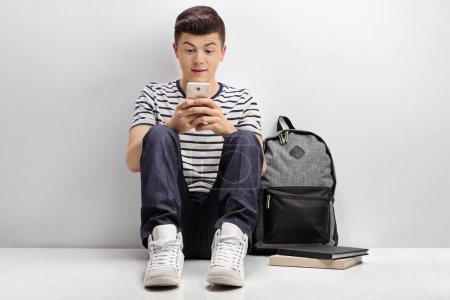 Teenage student using phone