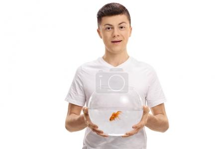 Teenager holding a bowl with a goldfish inside