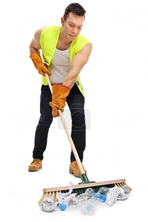 Waste collector cleaning with a broom