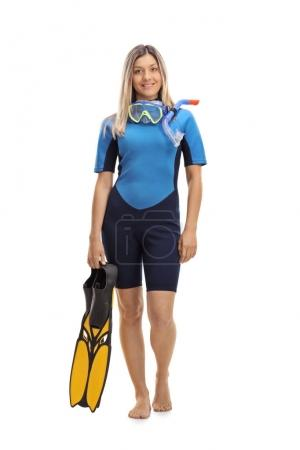 Woman in a wetsuit with snorkeling equipment