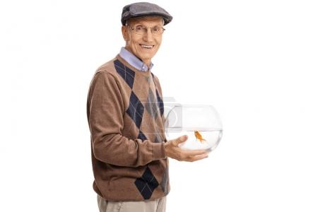 Elderly man holding a bowl with a goldfish
