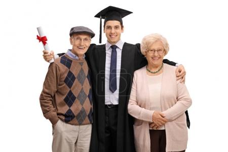 Graduate student posing together with his grandparents