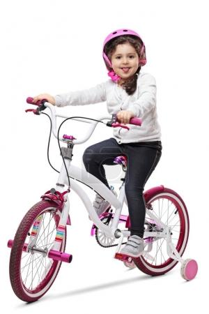 girl on a bike sticking her tongue out