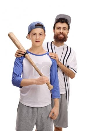 Baseball coach with a teenage player