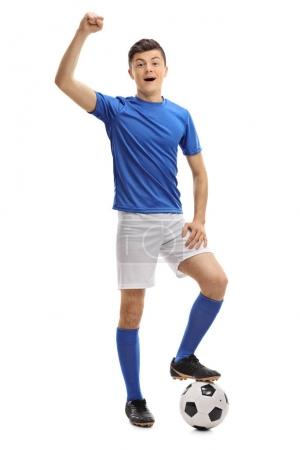 Photo for Full length portrait of a teenage football player gesturing happiness isolated on white background - Royalty Free Image