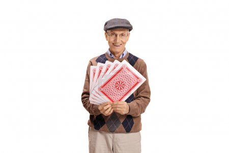 Senior with playing cards looking at the camera