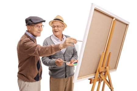 happy mature men painting on a canvas