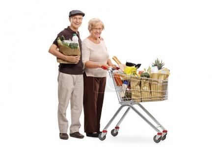 man with shopping bag and woman with shopping cart