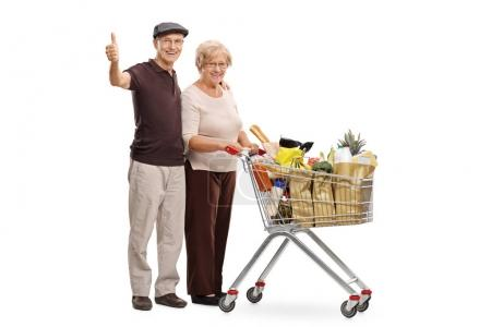 seniors with a shopping cart giving thumbs up