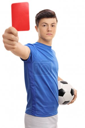 Teenage soccer player showing a red card