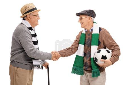elderly football fans shaking hands