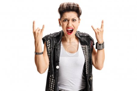 Angry punk girl making rock hand gesture