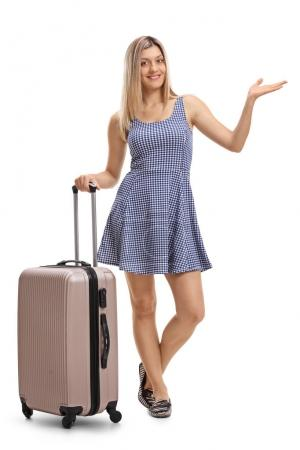 woman with a suitcase gesturing with her hand