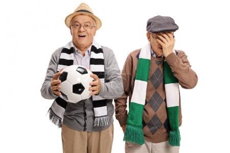 Two elderly football fans
