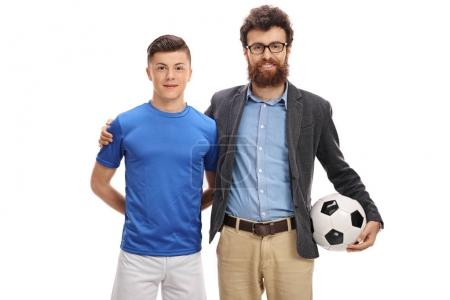 Teenage football player with his father