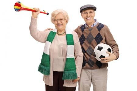 elderly soccer fans with a trumpet and a football