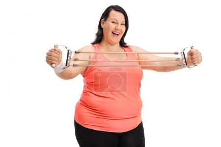 overweight woman exercising with a resistance band