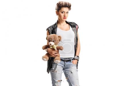 Punk girl holding a teddy bear