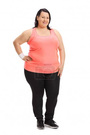 Overweight woman dressed in sportswear