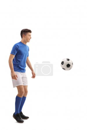Teen soccer player with a football