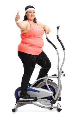 Overweight woman exercising and making thumb up sign