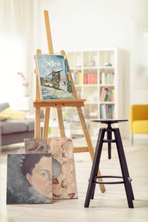 Chair, paintings and a canvas