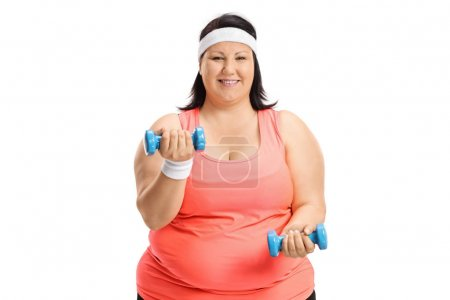 Overweight woman exercising with small dumbbells