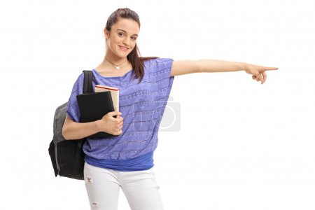 female student with a backpack and books pointing right