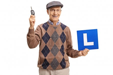 Elderly man holding a car key and an L-sign