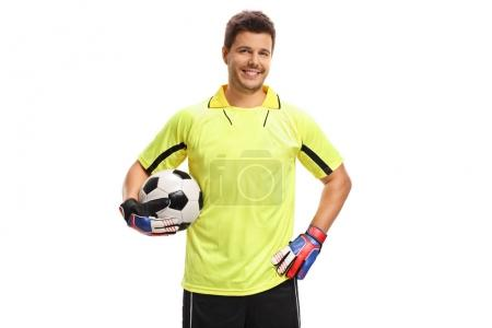 Goalkeeper with a football smiling