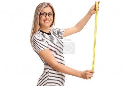 Young woman with a measuring tape