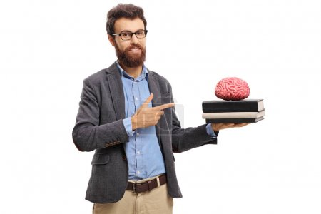 Teacher pointing at a brain model on top of books