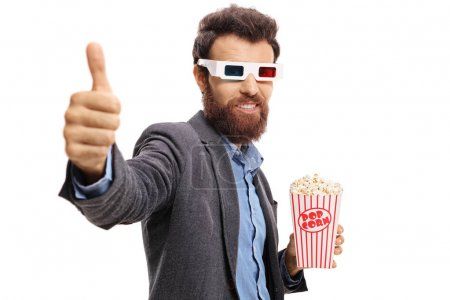 guy with 3D glasses and popcorn making thumb up
