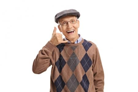Photo for Cheerful senior making a call me gesture isolated on white background - Royalty Free Image