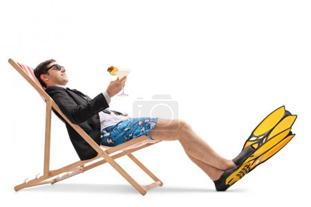 Photo for Businessman with swimming fins and a cocktail relaxing in a deck chair isolated on white background - Royalty Free Image