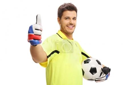 Goalkeeper holding a football and making a thumb up sign