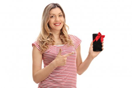 woman showing a phone with red ribbon and pointing